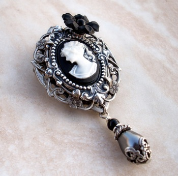 black_cameo_brooch_by_aranwen